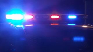 Close Up Police Car Lights Flashing At Night