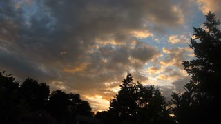 Colorful Clouds Over Trees Sunset Time Lapse
