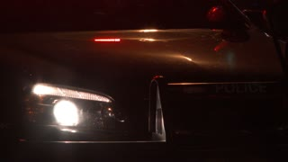Cop Car Lights Flashing At Night