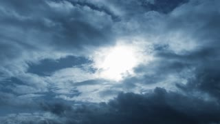 Dark Cloudy Blue Sky With Sun Shining Time Lapse