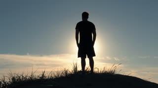 Dune Man Overlooking Sunny Sky
