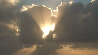 Epic Light Shining Through Cloudscape With Birds Flying Through Sky