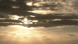 Epic Sun Drop Through Cloudscape Time Lapse