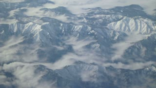 Flying Over Snow Capped Mountains