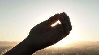 Hand Catching The Sun