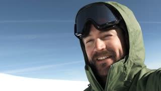 Happy Man Spinning On Snowy Mountain