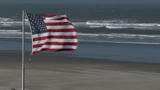High Winds Blowing American Flag At Beach