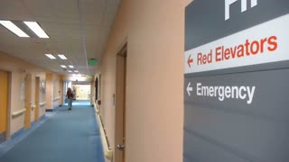 Hospital Hallway With Emergency Sign