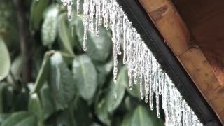 Ice Melting On Roof Eave
