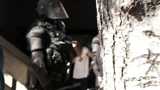 Innocent Young Woman Pepper Sprayed And Hand Cuffed By Riot Police