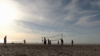 Kids Enjoy The Days Of Summer Playing Beach Volleyball