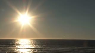 Large Sun Shining Bright Over Ocean Horizon