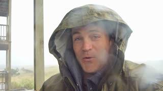 Man Having Fun In Rain Storm