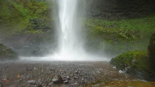 Man Hikes Into Large Waterfall