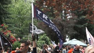 Man Holding Trump Flag At Rally