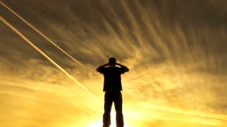 Man Looking Out Over Vast Yellow Sky