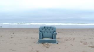 Man Sitting On Sofa Chair At The Beach