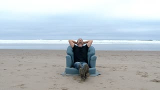 Man Sitting On The Ultimate Beach Chair