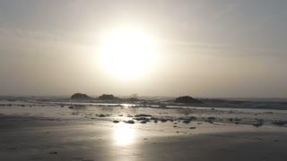 Man Walking Out On Beautiful Beach