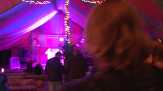 Masked Man At Nighttime Carnival