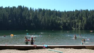 People Cooling Off At The Lake In Summer