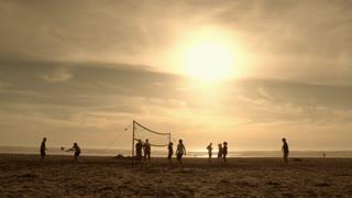 People Having Fun Playing Beach Volleyball