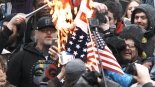 Angry Mob Burning The American Flag