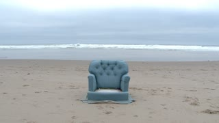 Person Finds A Cozy Sofa Chair On The Beach
