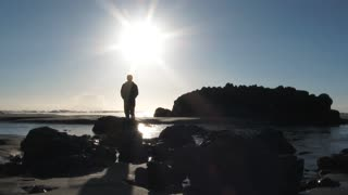 Person Standing Above The Rising Tide