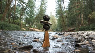 River Rocks Balancing On Water In Lush Forest