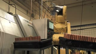 Robotic Arm In Production At Metal Factory