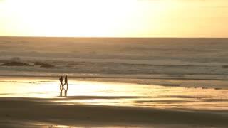 Stormy Sea Sunset Couple Walking Beach