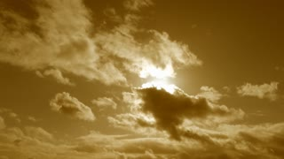 Sun Burst On Cloudy Warm Yellow Sky Time Lapse