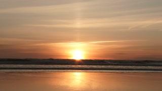 Sun Centered On Ocean Horizon