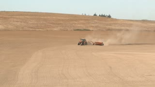Tractor Cultivating Soil In Field