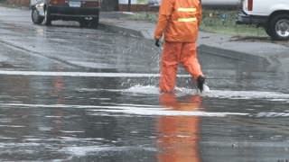 Utility Workers On Flooded Street
