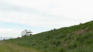 White Semi Truck Drive By