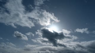 Wide Angle Sun Burst On Cloudy Blue Sky