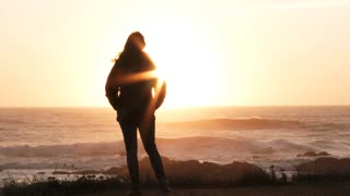 Woman At The Ocean Watching Beautiful Sunset Slow Motion