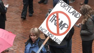 Woman Holding No Trump Sign
