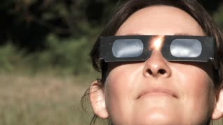 Woman Watching Solar Eclipse