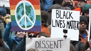 World Peace And Black Lives Matter Signs At Rally