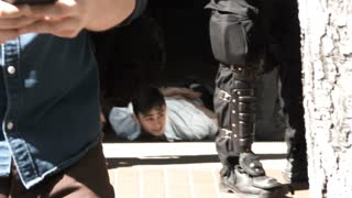 Young Man Ground Getting Arrested On The Ground