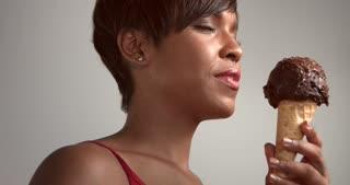 black woman bites an ice cream