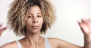 black woman with curly afro hiar portrait