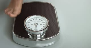 Checking the weight on a scale