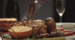 Close up video of carving homemade roasted chicken with oranges and rosemary on a Christmas party table