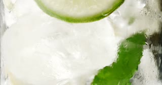 closeup of coctail. Mojito, tonik water with mint and lemon and lime and ice cubes