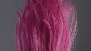 Closeup of pink hair creative colored texture slow motion from 60fps. lowed in air hair