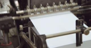 closeup of print machine tooks paper